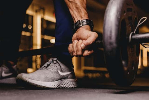 CBD for athletic recovery; a person lifting weights