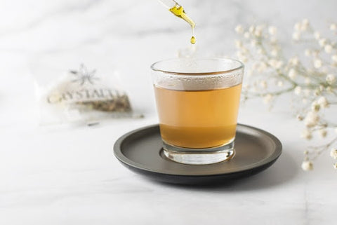 CBD and migraines; CBD oil being added to a cup of tea