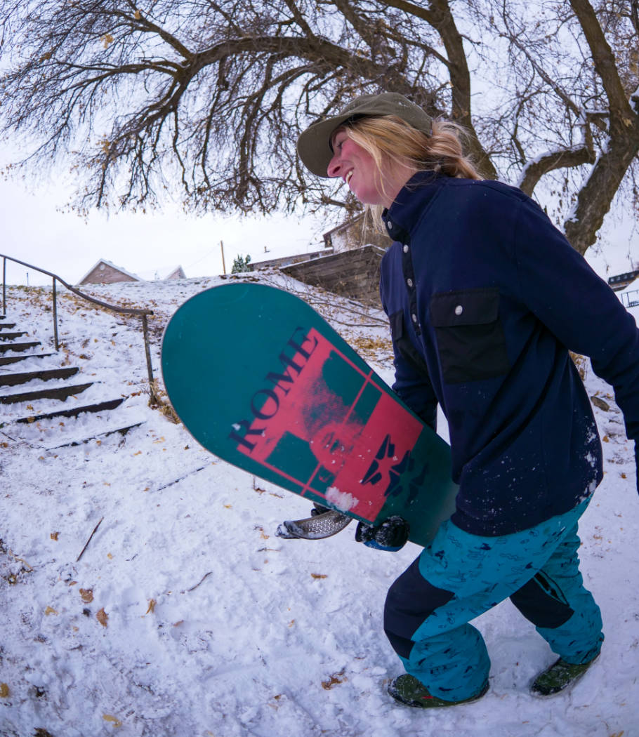 Madison Blackley hiking with her rome snowboard