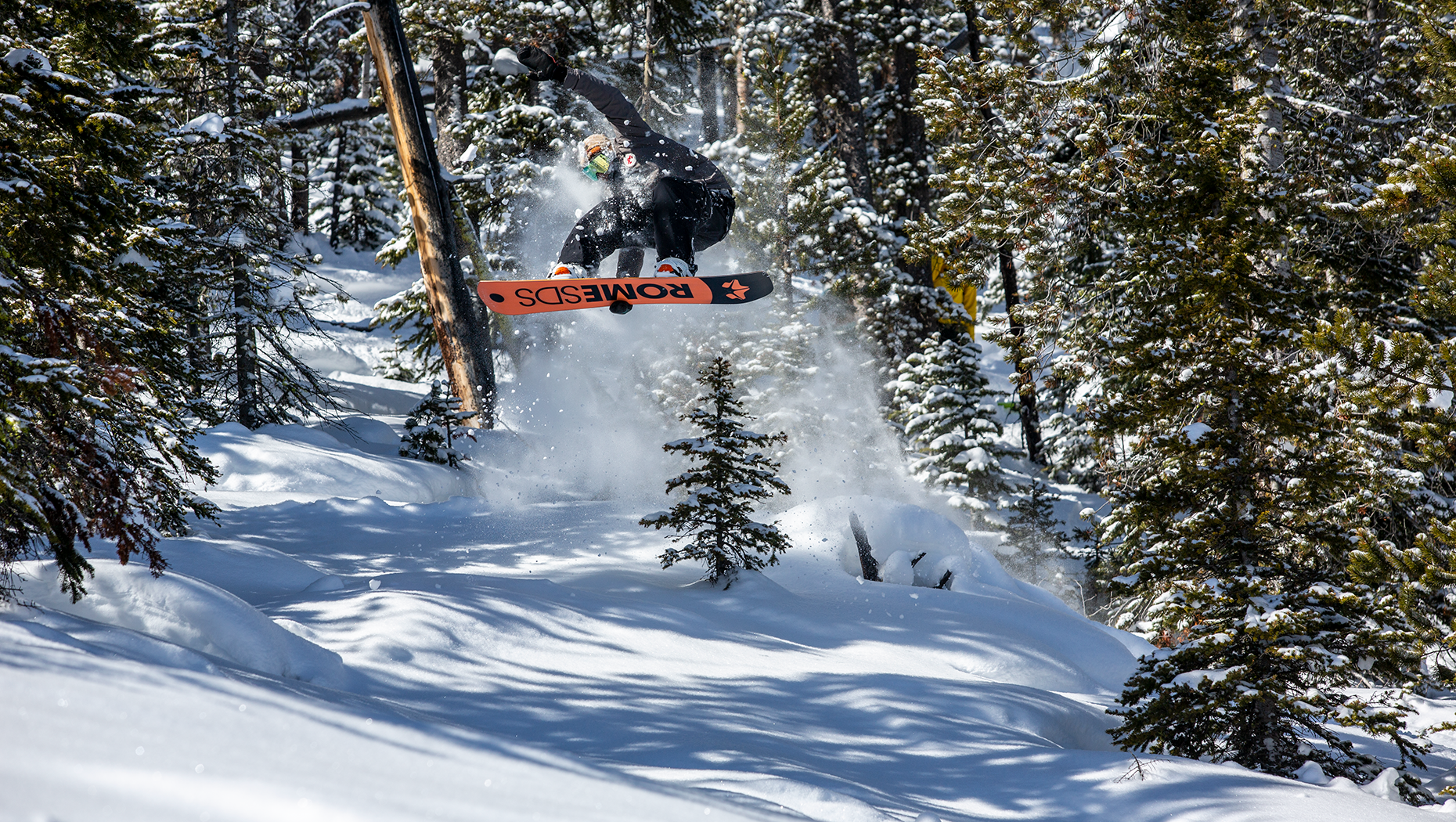 Ozzy Henning riding the powder on his rome snowboard
