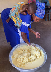 Mom making shea butter
