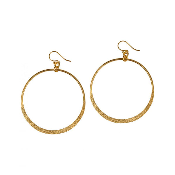 Large gold hoops with textured finish.