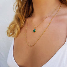 Load image into Gallery viewer, Model wearing gold necklace with a green onyx pendant, losange shaped, and gold figaro chain.