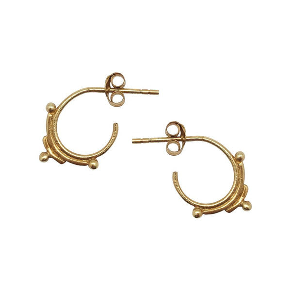 Small gold hoops with stud detail.