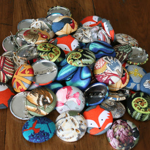 A variety of fabric badges, foxes, florals, kiwiana.