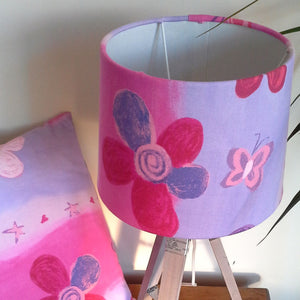 Pretty in pink fabric on medium drum lampshade with matching cushion.