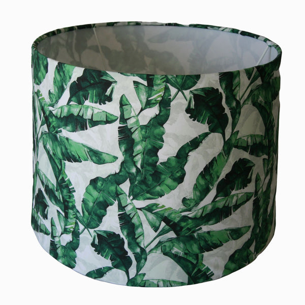 Banana leaves on white background on large drum lampshade