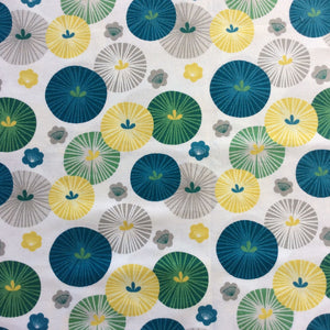 Circles of blue, green, yellow and grey on a soft white background.