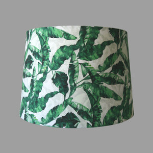 Green banana leaves on white background on large lampshade