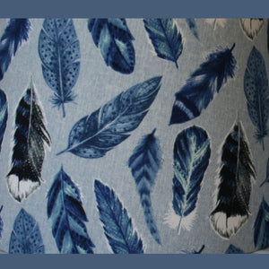 Large blue feathers with detail picked out in greys, blues, white and black. On a grey-blue background.