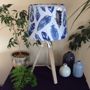 Tripod stand with blue feathers fabric lampshade