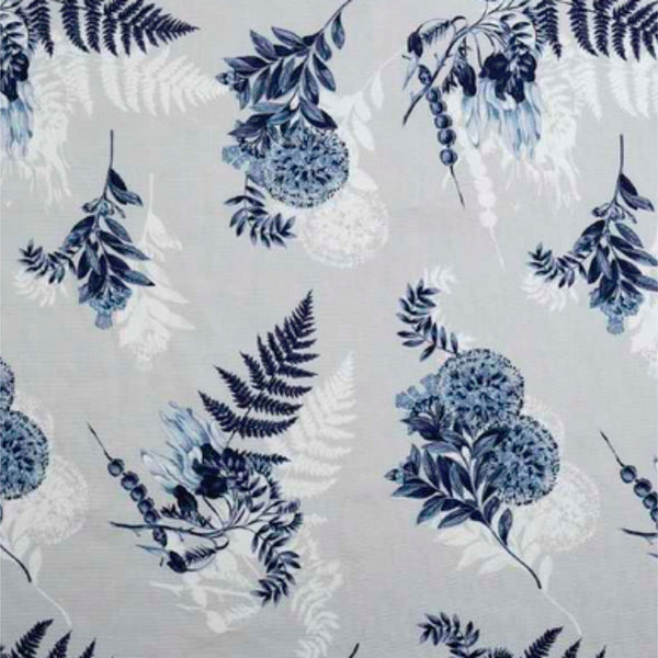 Fern leaves, flowers and kowhai branches in various blues, echoed in white on a dove grey background.
