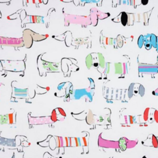 Fun variety of dogs in bright colours on white background fabric.