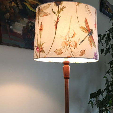 Thistle and dragonfly pattern on lit light shade