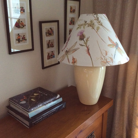 Large conical lampshade in dragonfly fabric on ginger jar stand