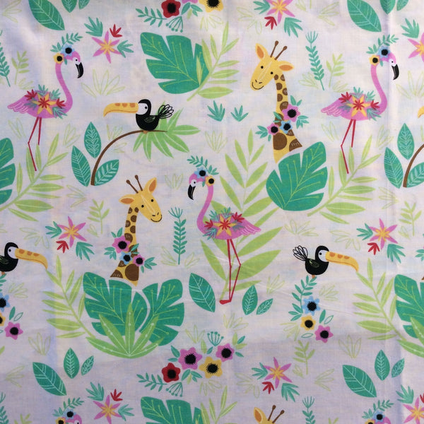 Flamingo and giraffe fabric, wide angle. Leaves and flowers accompany the birds and animals.