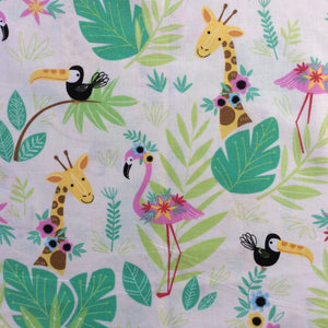 A pink flamingo, the head and shoulders of two giraffes and a couple of black and white toucans star on this fabric on a white background.