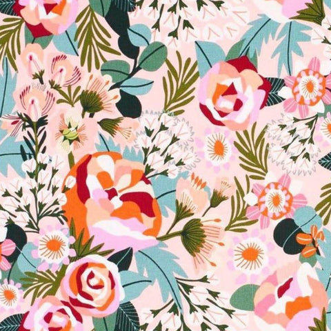 Bright pops of red, pink and blues in a pattern of flowers and leaves.