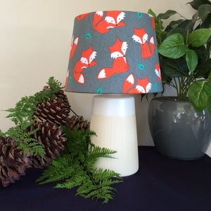 Small cream and white light stand with a cute fox fabric lampshade