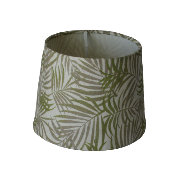 Green and grey fern leaves on a small tapered lampshade.
