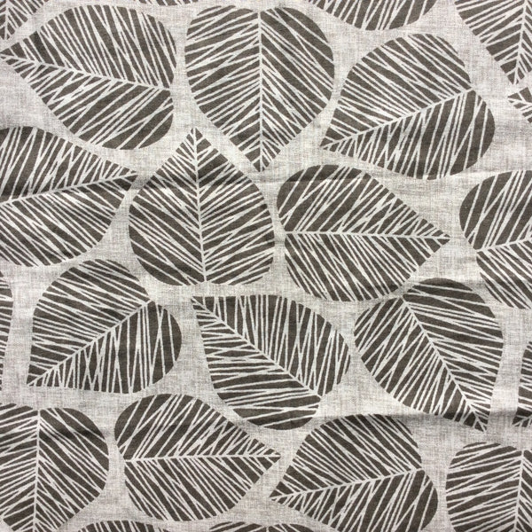 Dark grey leaves with white veins on white background. Close up of fabric.