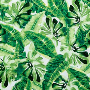 Densely packed large leaves in a variety of green fabric.