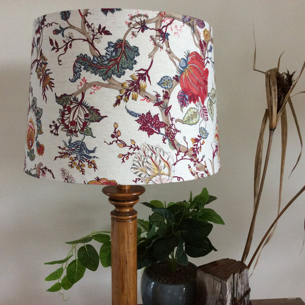 Oriental floral fabric on large tapered shade close up