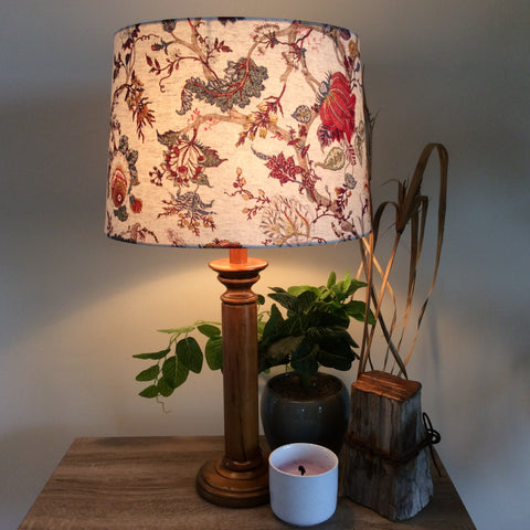 Large tapered light shade with oriental floral fabric. Lit up
