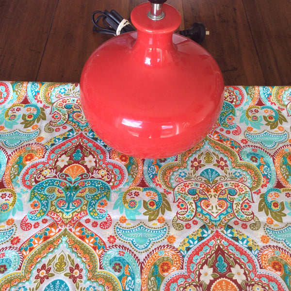 Paisley fabric and a red lamp base