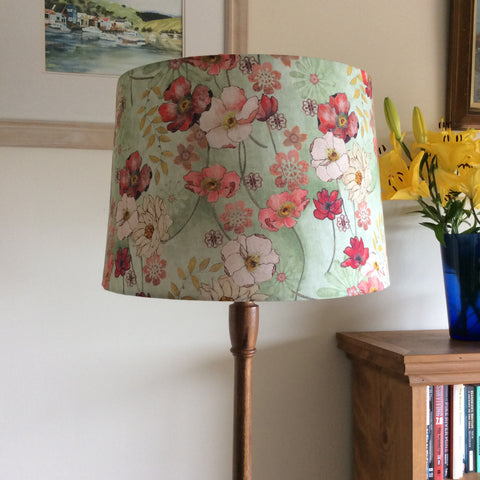 Multi-colour poppies fabric on a large tapered light shade and wooden floor stand