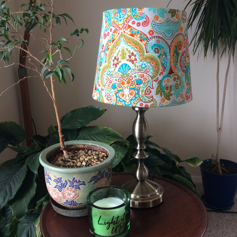Teal paisley fabric on brass table stand