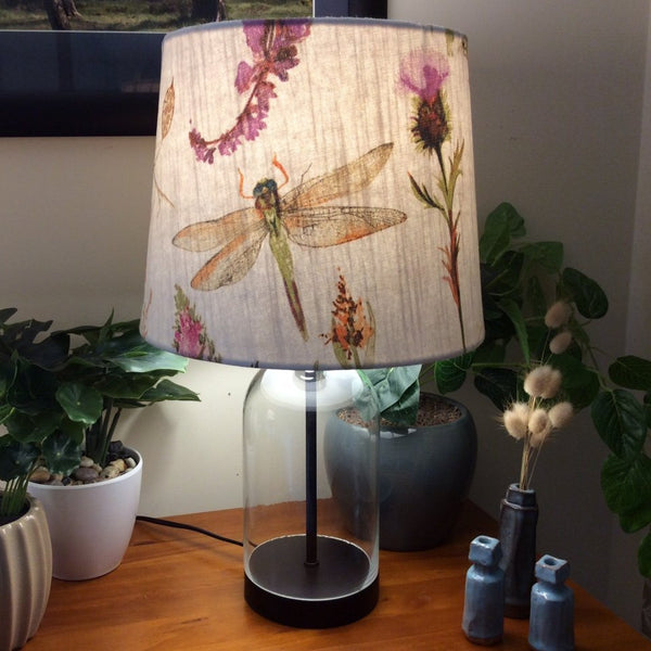 Glass bottle table lamp with dragonfly fabric shade