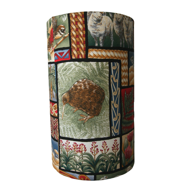 The kiwiana nature fabric on a long barrel lampshade that hightlights New Zealand's indigenous kiwi bird.
