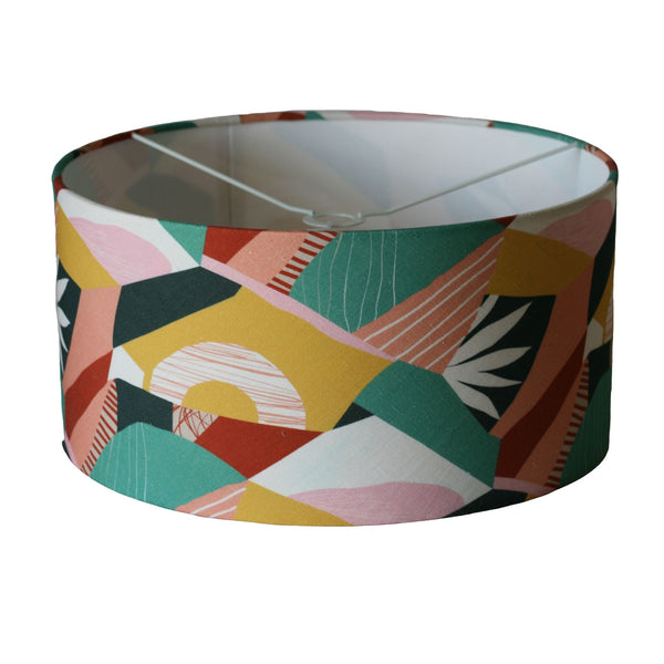 Multi-coloured abstract fabric used on a large barrel lampshade designed to hang from the ceiling.