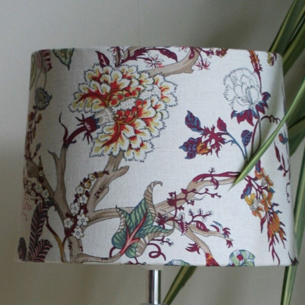 Medium tapered lampshade with fabric of swirls of foliage in warm browns, creams and reds.