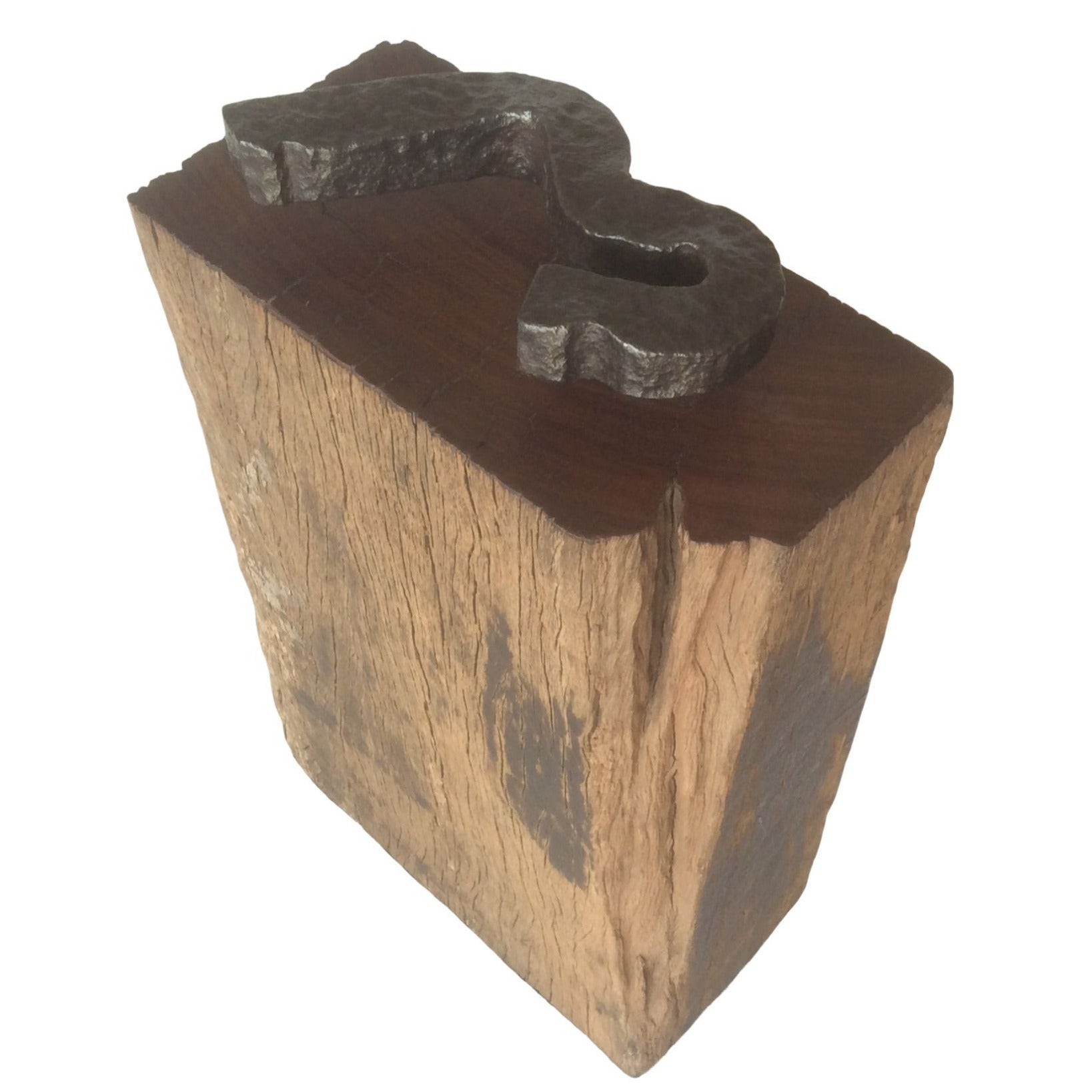 Recycled wharf timber with rail anchor and weathered edges, top view.