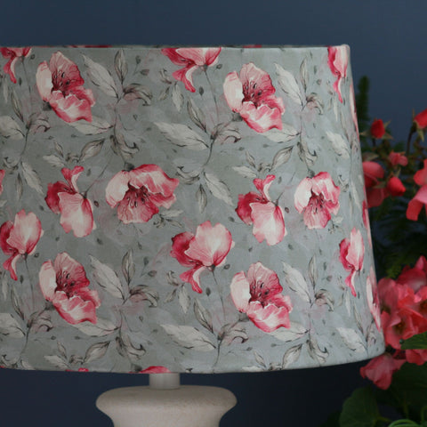 Roses on grey fabric made into a medium tapered lampshade.