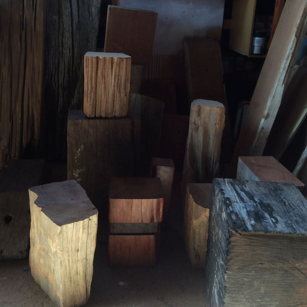 Blocks of timber at various stages in John's workshop.