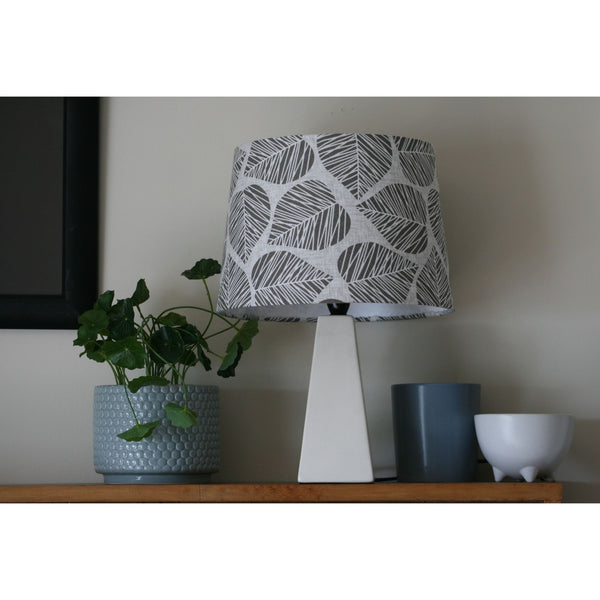 Grey leaves fabric lampshade on table lamp.