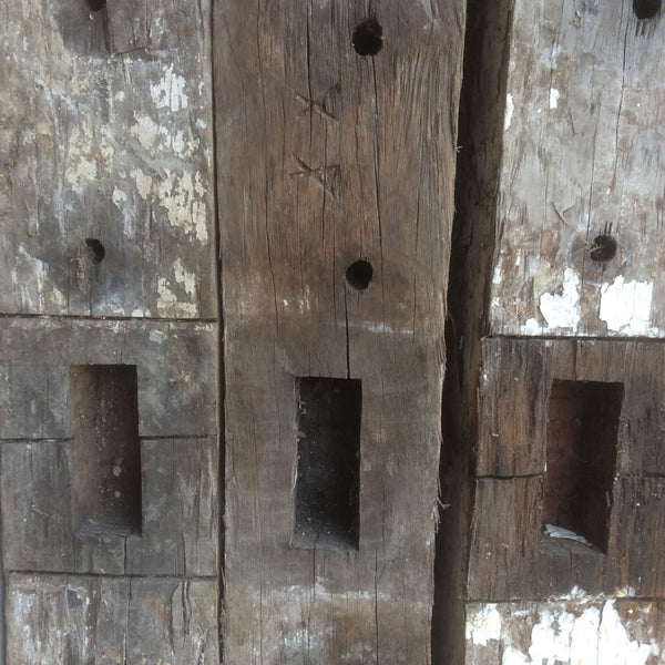 Keep Me Posts as they start out, old wooden timber posts waiting to be recycled.