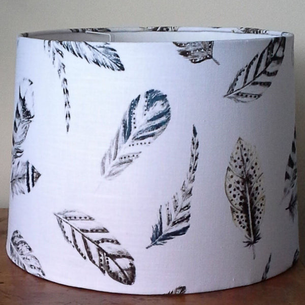 Large white feather fabric on a large tapered lampshade.