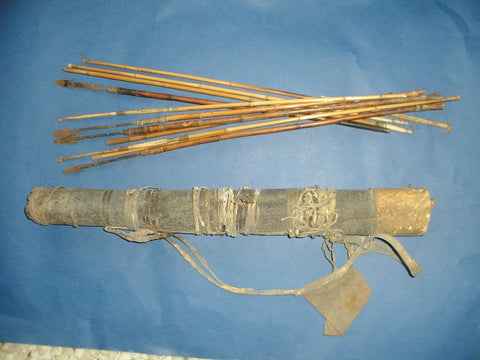 Very old bark quiver and bone / metal tip arrows
