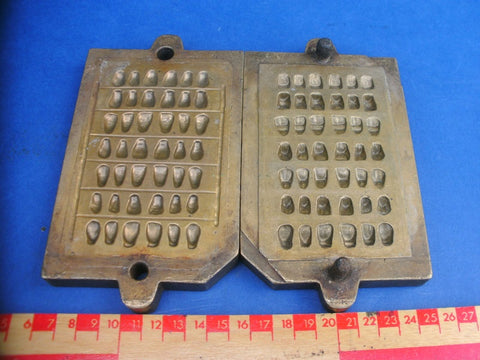 Antique brass false teeth dental mould.