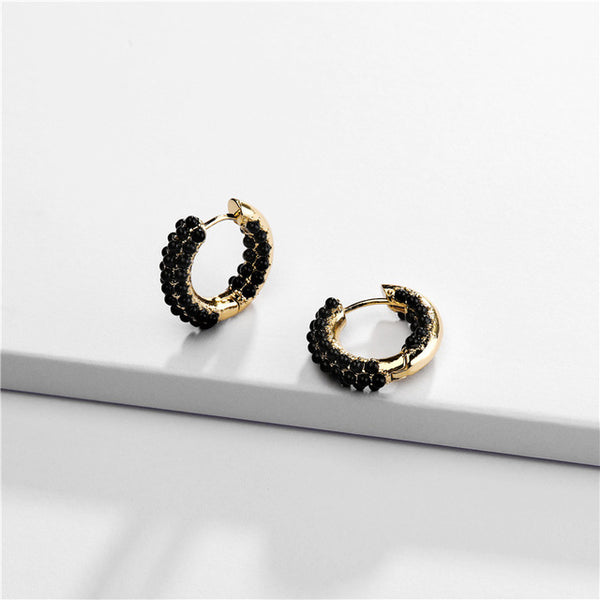 Omega Gold Earrings with Onyx
