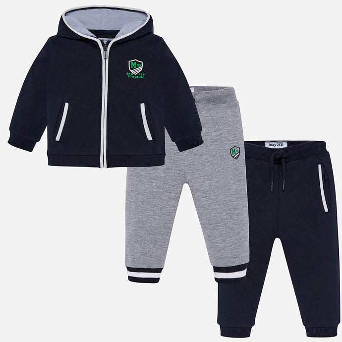 Mayoral Singapore Toddler Boy Set. Three-piece tracksuit set for little boys by Mayoral, made in soft and stretchy jersey. The navy and grey joggers both have an elasticated drawstring waist. The navy blue cotton piqué zip-up top has white trims, and matching logo prints on the front and back.