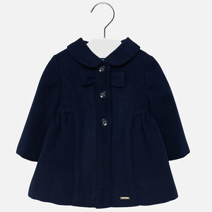 A superbly soft and smart navy coat for girls by Mayoral. The coat is styled classically, with long sleeves, a rounded peter pan style collar and button fastenings with a bow to the front. It will look fashionable in the winter with a dress and tights from the label.