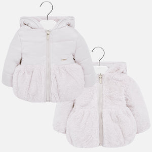 Girls reversible grey puffer jacket by Mayoral, softly padded and lined for added warmth. The jacket has a soft fur on one side and smooth polyester design on the other. Both sides feature an attached hood and long sleeves. Finished with a zip fastening and branded gold pull tab running down the front, this sweet Mayoral infant girl's jacket is the perfect winter wardrobe addition.