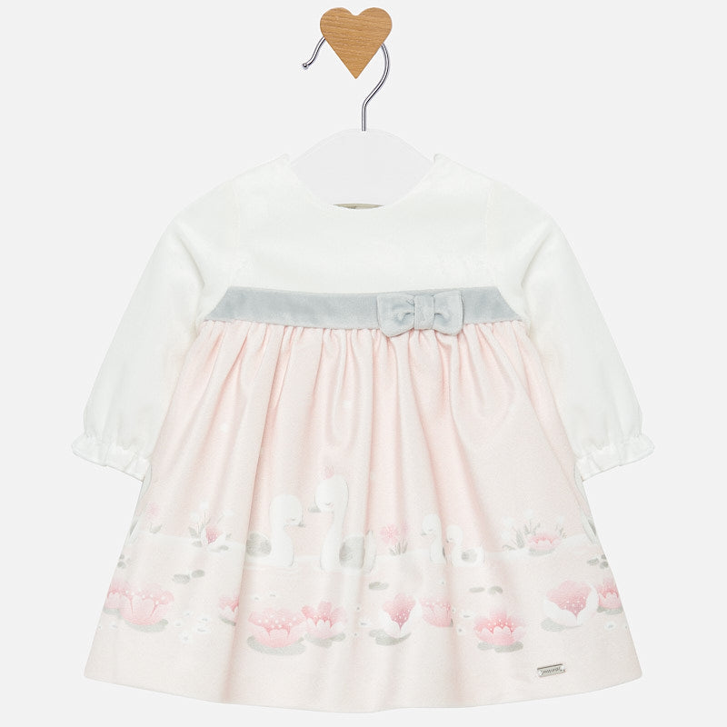 Mayoral Singapore Dress for Baby Girls. Sweet and charming, this white and pink dress from Mayoral will make sure they have the perfect outfit for everything from dinner to parties. It features an adorable swan graphic on the front and is fitted with a hidden zipper on the back. The skirt is slightly gathered on the waist. Pair with ballet flats and a velvet headband.