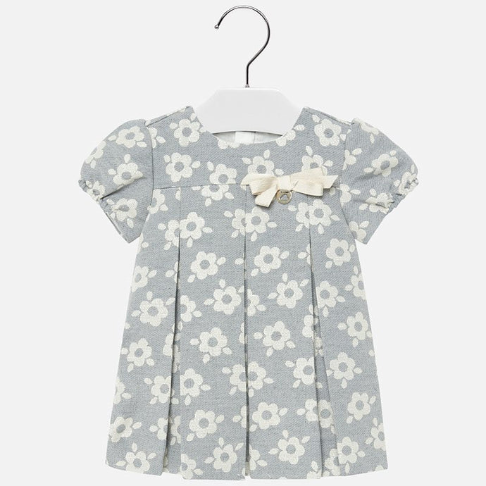 Mayoral Singapore Floral Dress. An adorable choice for parties and family gatherings for baby girls from Mayoral. This grey dress features a floral print, a round neckline and capped sleeves. Add a headband and a pair of Mary Janes to complete the look.