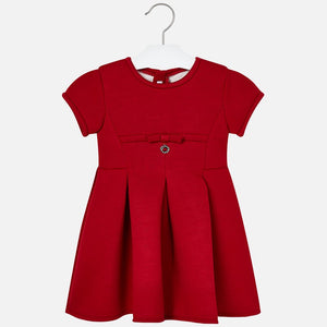 Mayoral Singapore Red Dress. Red dress from Mayoral, made in a smooth, polyester blend. The design features a round neckline, a bow and a zip fastening on the back.